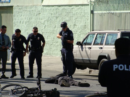 LAPD Points Gun at Wounded Resident [Courtesy Charles Porter]