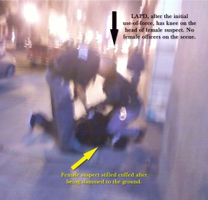 Immediately after the female suspect was slammed to the ground by male officers. (Photo taken by Bilal Ali)